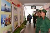 Une exposition photographique pour célébrer les 70 ans de l'Armée populaire du Vietnam