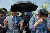 MH17 : arrivée en Malaisie d'un avion transportant des corps de victimes