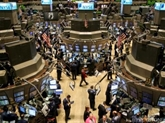 Wall Street finit en hausse, Nasdaq et S&P 500 à des records