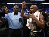 Boxe : Mayweather remporte le