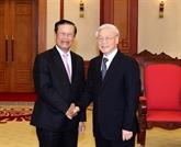Des dirigeants du Parti et de l'État reçoivent un dirigeant lao