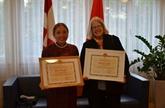 Deux personnes représentatives de l'amitié Suisse - Vietnam