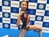 Une jeune Vietnamienne en or à la Coupe du monde d'aérobic au Japon