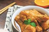 Cuisses de poulet sautées à l'orange