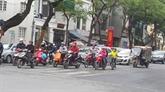 La plupart des Vietnamiens respectent le port du casque de moto