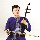 Lartiste Trân Van Xâm fait revivre la viole à deux cordes