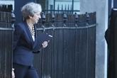 Brexit: May tente de désamorcer la grogne de sa majorité