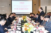 Le PM vietnamien participe à un échange de vue avec des groupes chinois