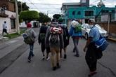 La caravane de migrants arrive, fragmentée, à Mexico