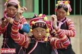 Le superbe turban féminin de l'ethnie La Hu