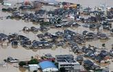 Intempéries au Japon: près de 60 morts et un difficile combat contre l'eau
