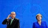 Merkel et Erdogan affichent une timide détente malgré de