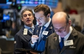 Wall Street termine en ordre dispersé, Dow Jones et S&P 500 à des records