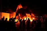 Irak : au moins 13 manifestants tués, consulat iranien incendié à Najaf