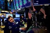 Wall Street termine en légère hausse face à une Fed toujours prudente