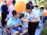 Près de 26 milliards de dôngs pour les handicapés et les enfants orphelins