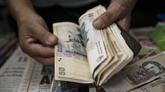 L'Argentine gèle le taux de change du peso pour stopper l'inflation