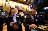 Wall Street termine en ordre dispersé au début d'une semaine chargée
