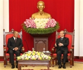 Trân Quôc Vuong reçoit une délégation du Parti populaire révolutionnaire du Laos