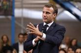 Macron durcit le ton sur l'immigration, prudent sur les retraites