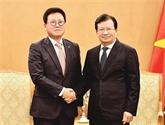 Le vice-Premier ministre Trinh Dinh Dung reçoit le directeur général de Lotte Asset Development