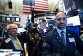 Wall Street démarre l'année en grimpant à de nouveaux records