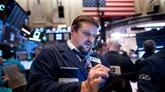 Wall Street quasi-stable après la décision de la Fed et une salve de résultats