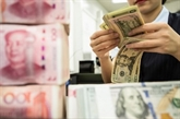 Signature d'un accord de coopération dans le règlement en monnaies
