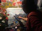 Le vieux peintre du pont Long Biên