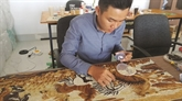 Les grains de riz, la passion d'un jeune artiste de Cân Tho