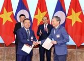 EVN signe des protocoles d'accord d'achat d'électricité avec le Laos