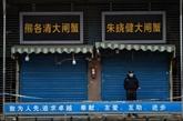 Chine : l'épidémie contamine les marchés, les Bourses dévissent