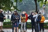 COVID-19 : Les visiteurs étrangers confiants en les mesures prises par Hanoï