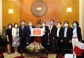 Des Vietnamiens en Thaïlande et en R. de Corée soutiennent la lutte contre le COVID-19
