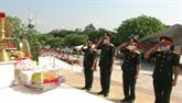 Inhumation des restes de 26 volontaires vietnamiens tombés au Laos