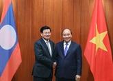 Le Premier ministre laotien au Vietnam pour renforcer les liens