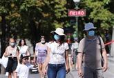 Vingt millions de cas dans le monde, les Parisiens masqués