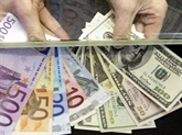 Le dollar américain stable face à l'euro, la livre monte