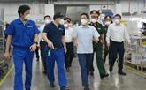 Le vice-Premier ministre Vu Duc Dam inspecte des activités de production à Hô Chi Minh-Ville