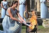 JO-2022 : la flamme olympique allumée sur le site grec d'Olympie à huis clos