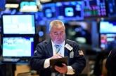 Wall Street termine en ordre dispersé, Dow Jones et S&P 500 à un souffle du record