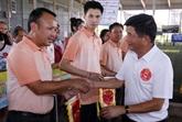 Compétitions sportives entre des experts vietnamiens en Police au Laos