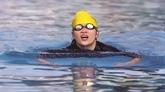 La nageuse Nguyên Thi Sari surfe sur les vagues de la vie