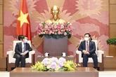 Le président de l'Assemblée nationale du Vietnam reçoit l'ambassadeur du Laos