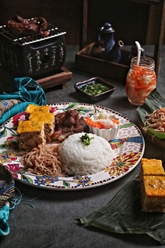 Le com tâm, plat emblématique de la cuisine méridionale
