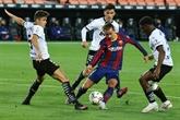 Le Barça se fait peur à Valence, mais reste en course pour le titre