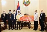 COVID-19 : la communauté des Vietnamiens au chevet du Laos