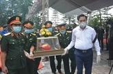 Inhumation des restes d'une centaine de soldats et experts vietnamiens tombés au Laos
