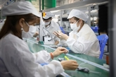 La BM met en garde contre l'impact continu de COVID-19 sur l'industrie manufacturière du Vietnam
