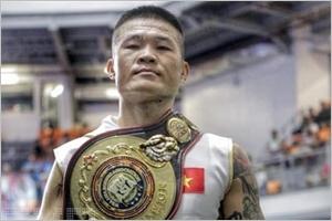 Le boxeur Truong Dinh Hoang remporte la ceinture de la WBA dAsie